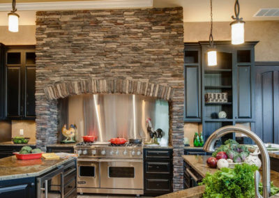 Modern kitchen using natural stone accents