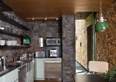 Modern Kitchen with irregular and cut stone accents