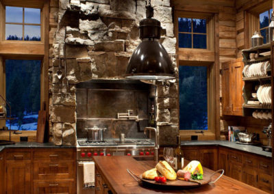Rough cut stone in a modern kitchen with rustic hearth.