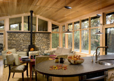 Natural stone and wood in a modern dining/kitchen area.